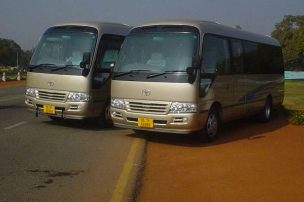 Toyota Coaster Japanese 13 seater - Imported Luxury Vans Rental Company - Car Rental Delhi